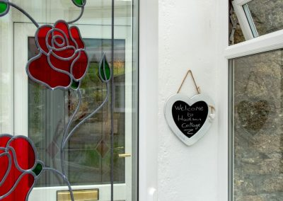Stained glass rose and welcome sign